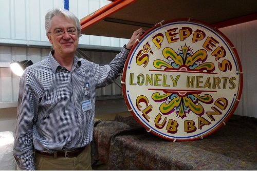 Photograph of Matthew H Goldsmith, Picture Restorer & Director, Trade Paintings Service Ltd, with restored Sgt. Peppers Lonely Hearts Club Band drum.